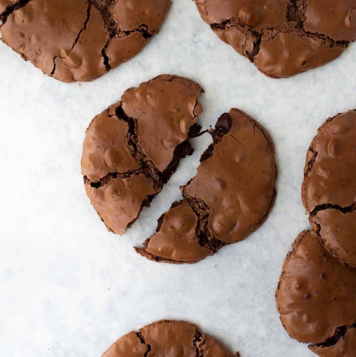 chocolate cookie broken into two on marble surface