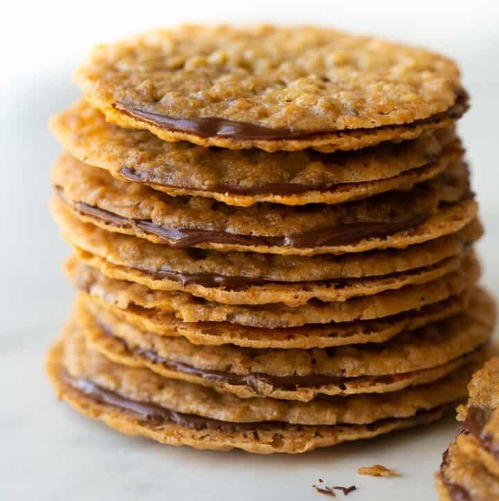 stack of lace cookies on marble slab