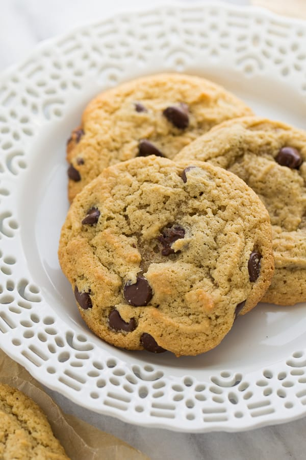 close up shot of almond flour chocolate chip cookies on white plate