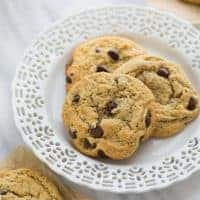three chocolate chip cookies on a white plate
