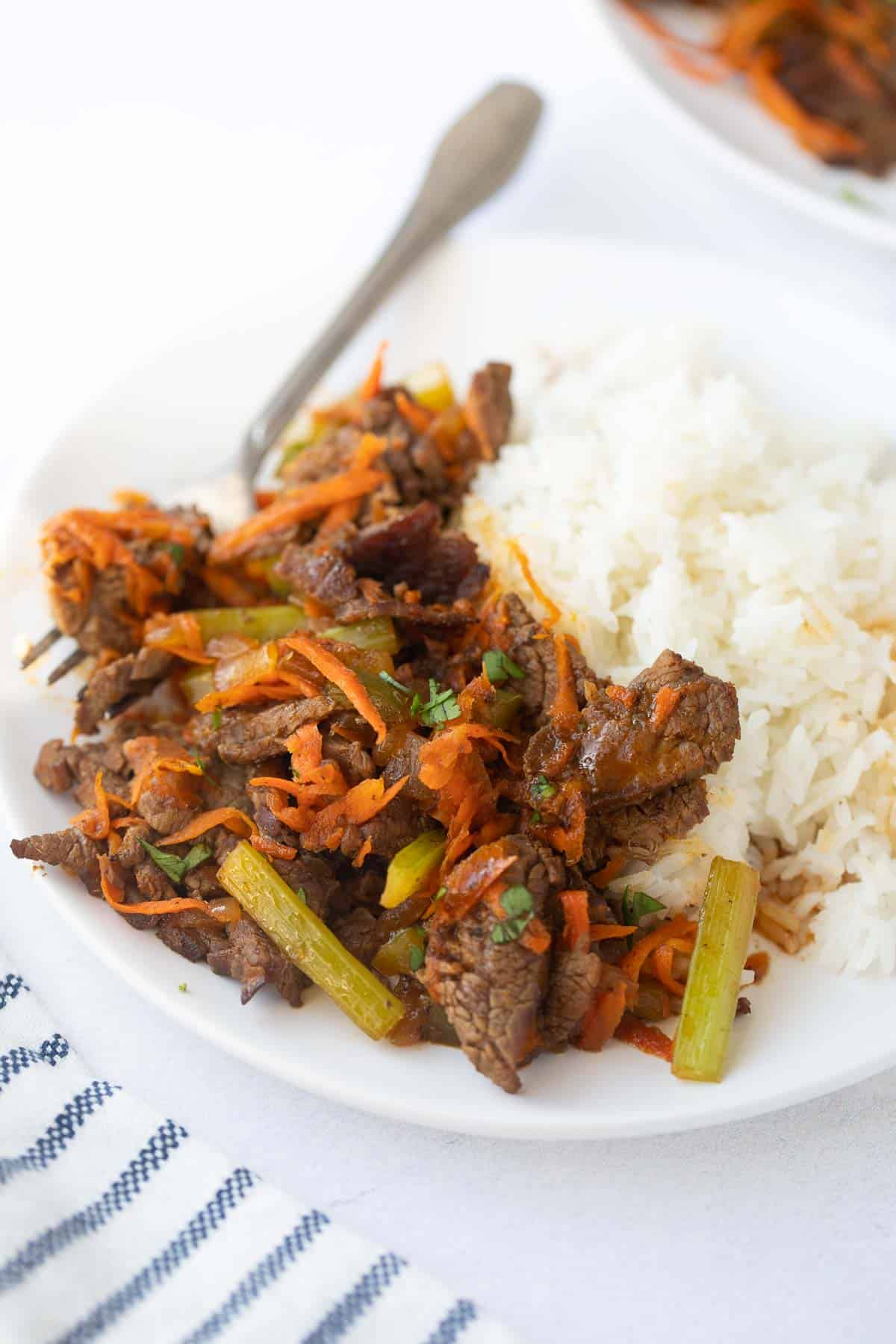 beef stir fry on a plate with white rice