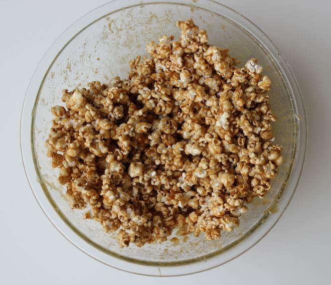 Caramel corn in glass bowl while baking