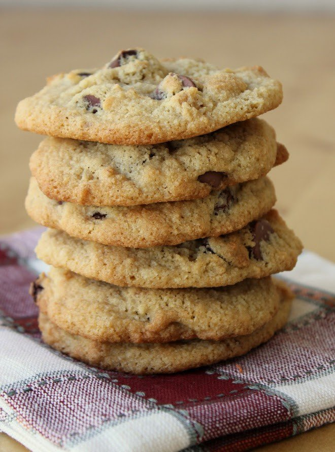 stack of almond flour cookies on red and white dish towel