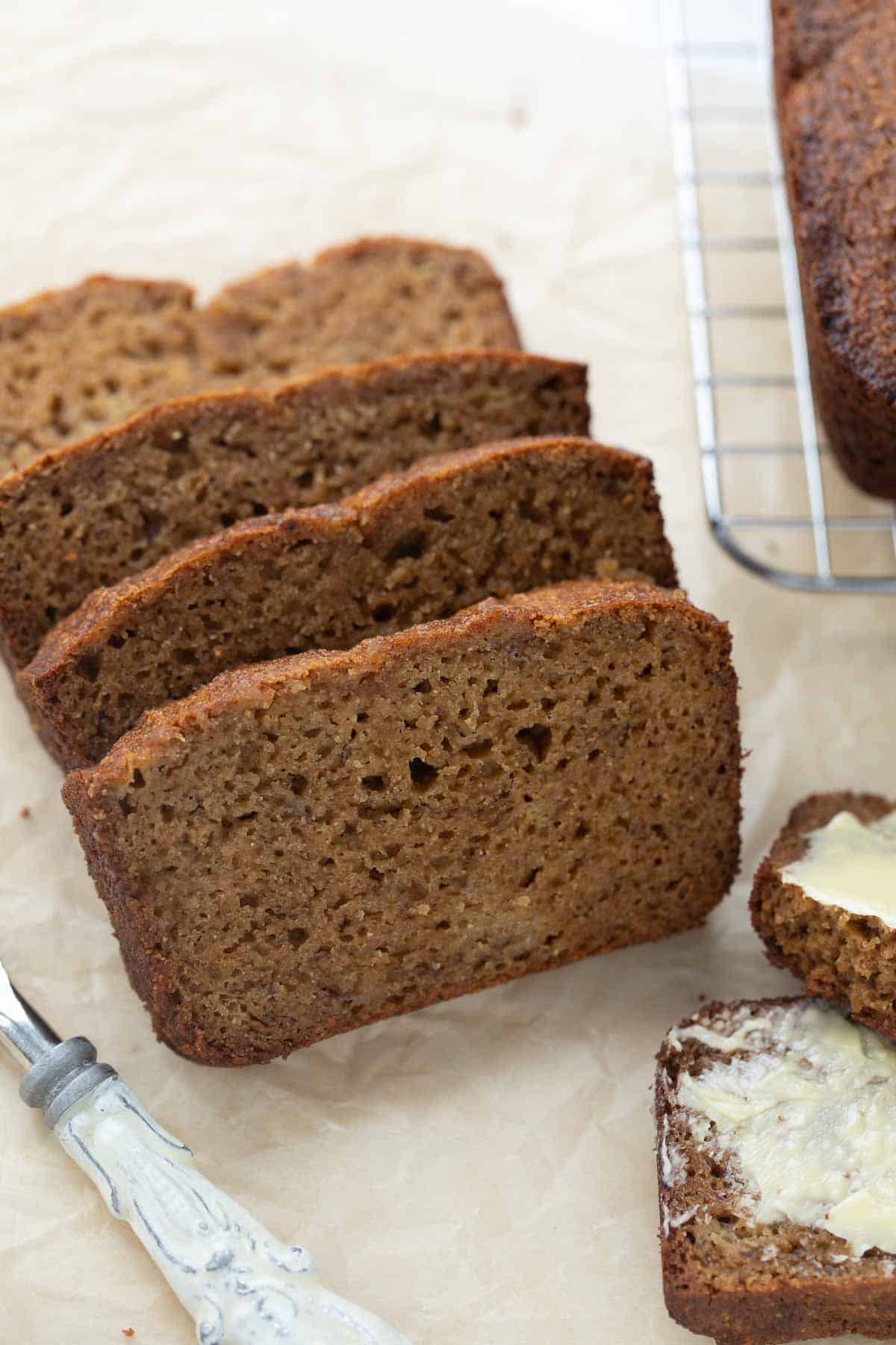 loaf of paleo banana bread cut into slices