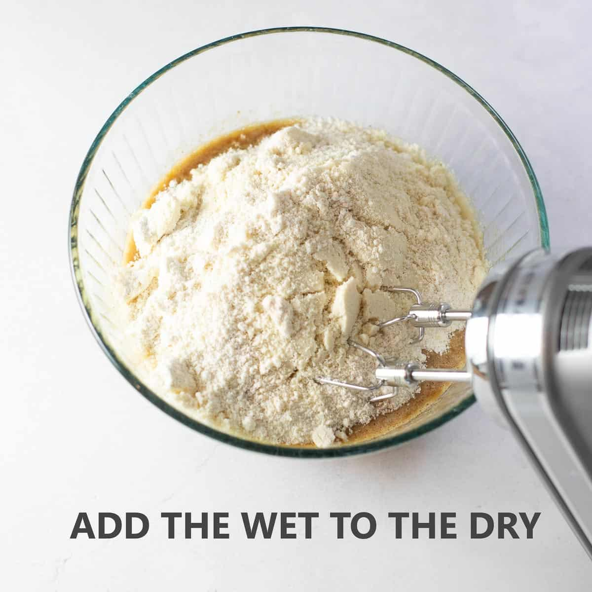 """titled photo of step by step recipe instructions for banana bread: """"add the wet to the dry"""""""