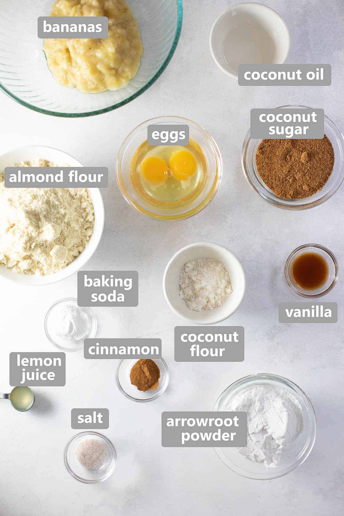 overhead shot of ingredients to make paleo banana bread set out in bowls