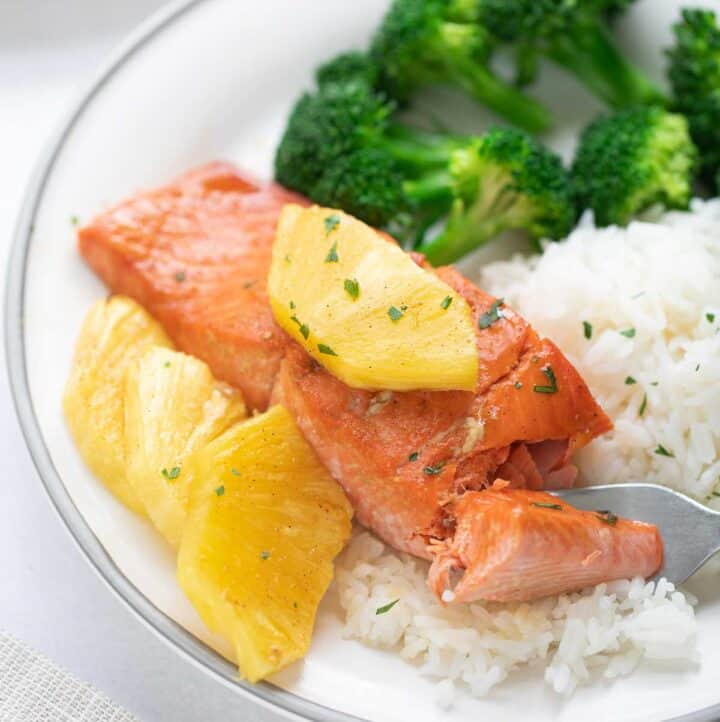 maple glazed salmon filet topped with pineapple slices