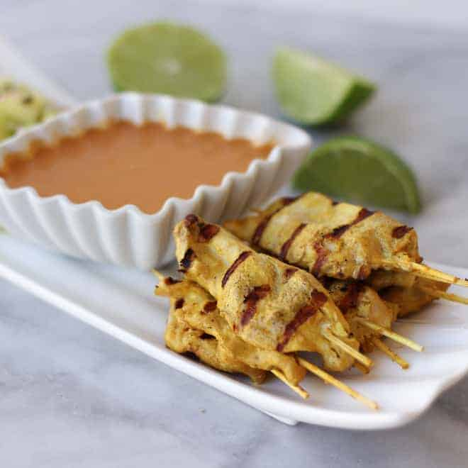 Side angle view of Chicken Satay with Peanut Dipping Sauce