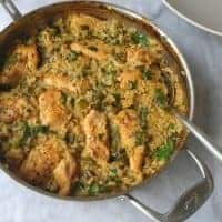 Skillet chicken with mexican green rice in a pan
