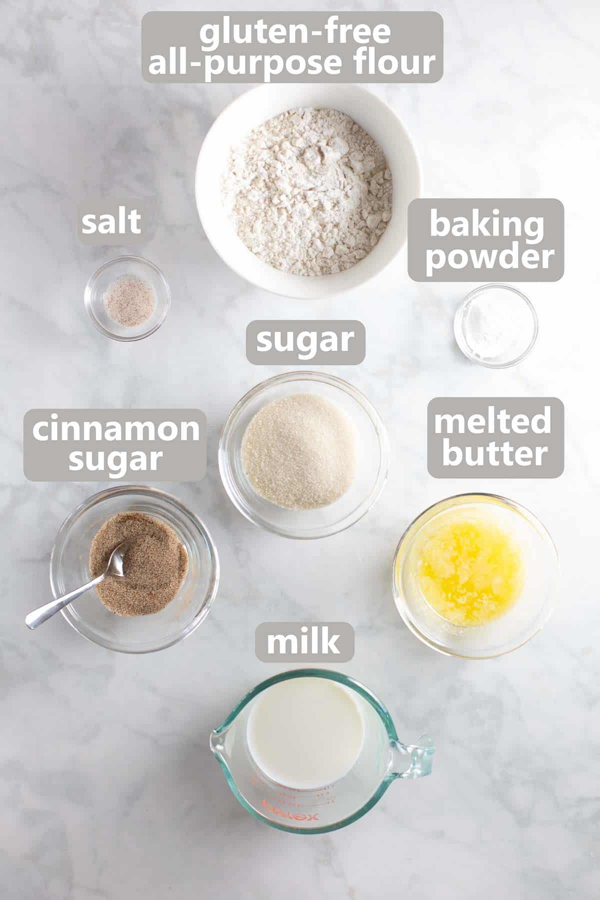 ingredients for topping in bowls on marble background