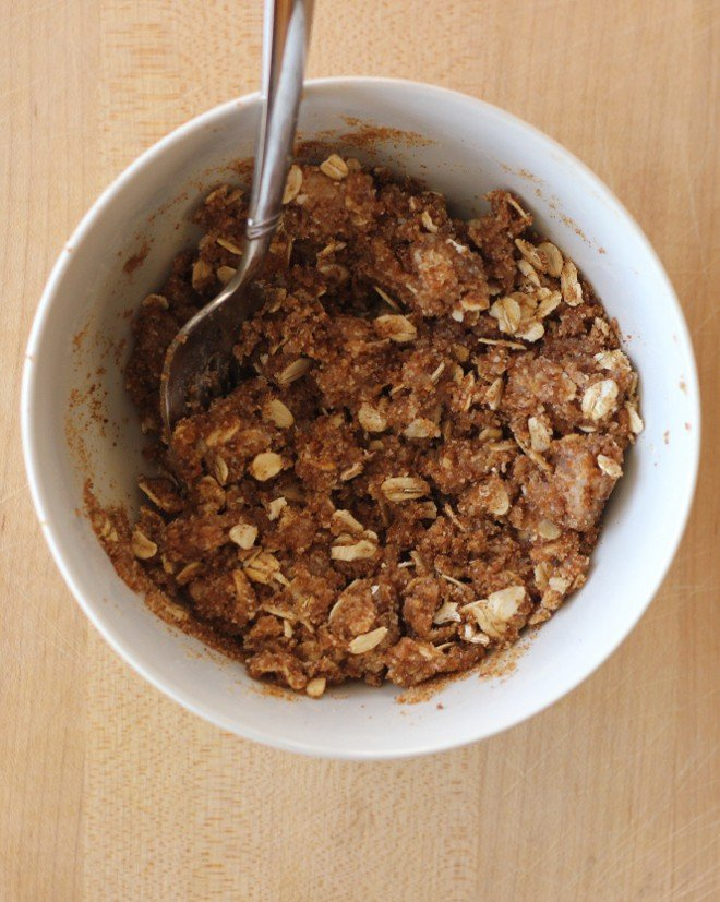 Bowl of oats mixed with brown sugar and butter