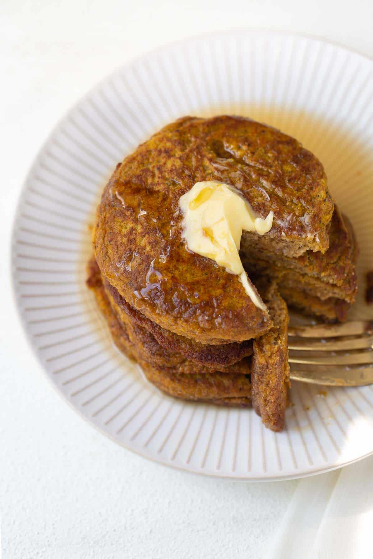 healthy pumpkin pancakes with bite on fork
