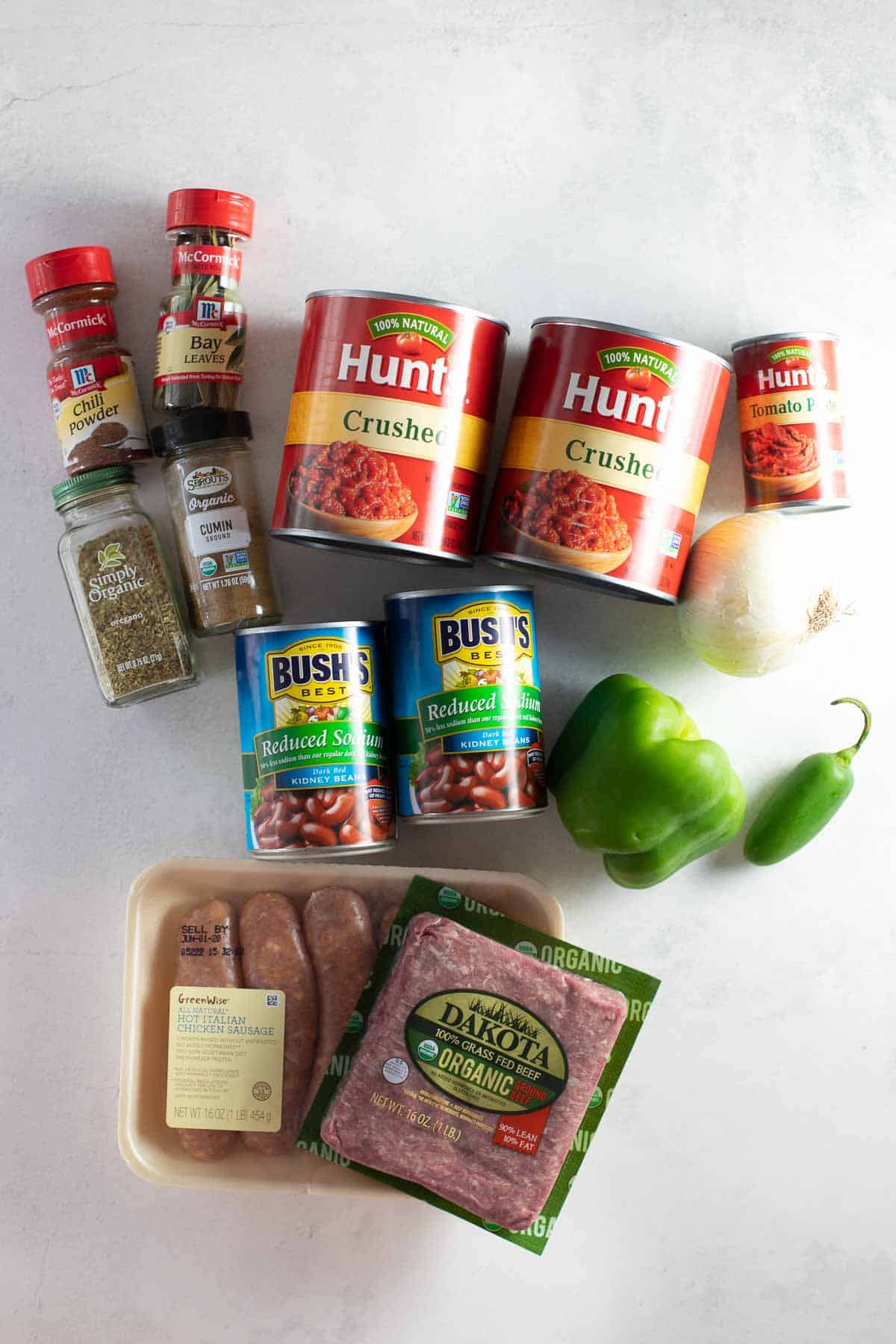 ingredients for gluten-free chili set out on marble background