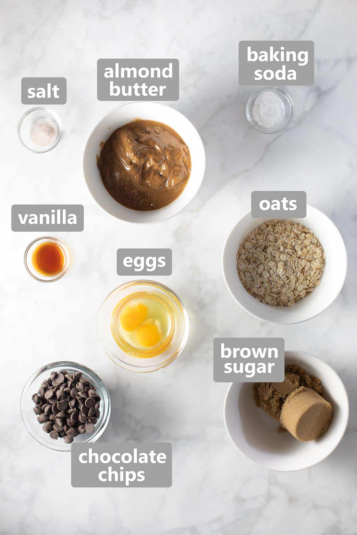 ingredients set out in bowls on marble background