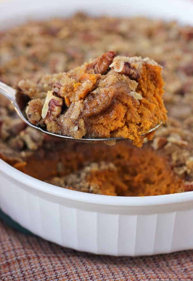 gluten-free sweet potato casserole being scooped out of baking dish