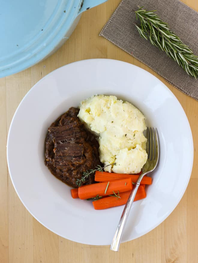 Beef mashed potatoes and carrots on a white plate
