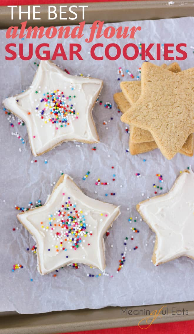 image for pinterest of frosted sugar cookies on baking sheet with sprinkles