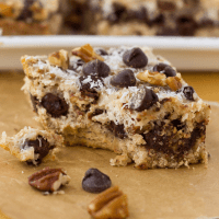 Sideview of cookie bar with a bite taken from it