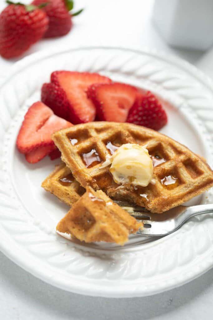 fork taking bite of oat flour waffle