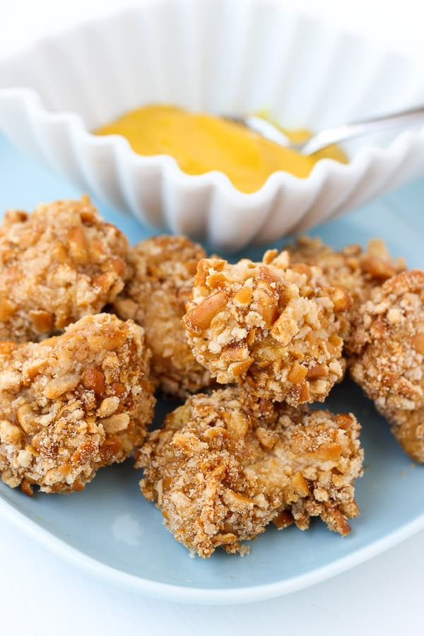 Gluten-Free Pretzel Crusted Chicken Bites! Quick, easy and so delicious you'd never guess they're gluten-free!