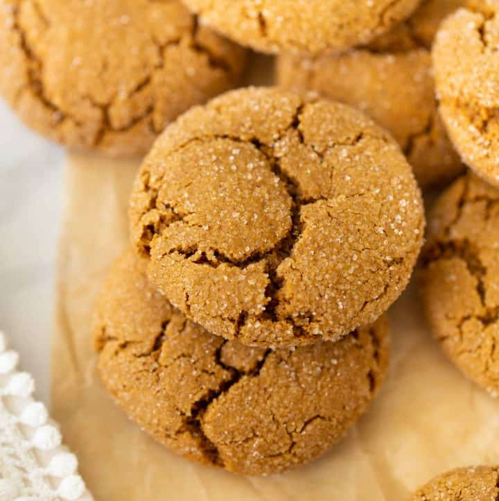 gluten-free molasses cookies up close on brown parchment paper
