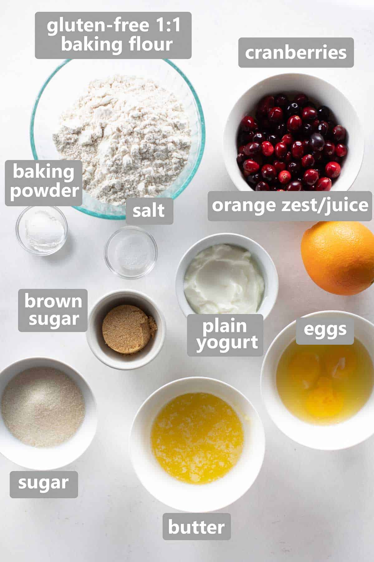 overhead shot of ingredients to make the muffins in bowls on white background