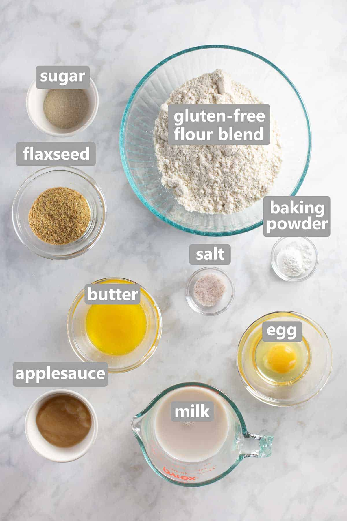 overhead shot of ingredients for gluten-free pancakes set out in bowls