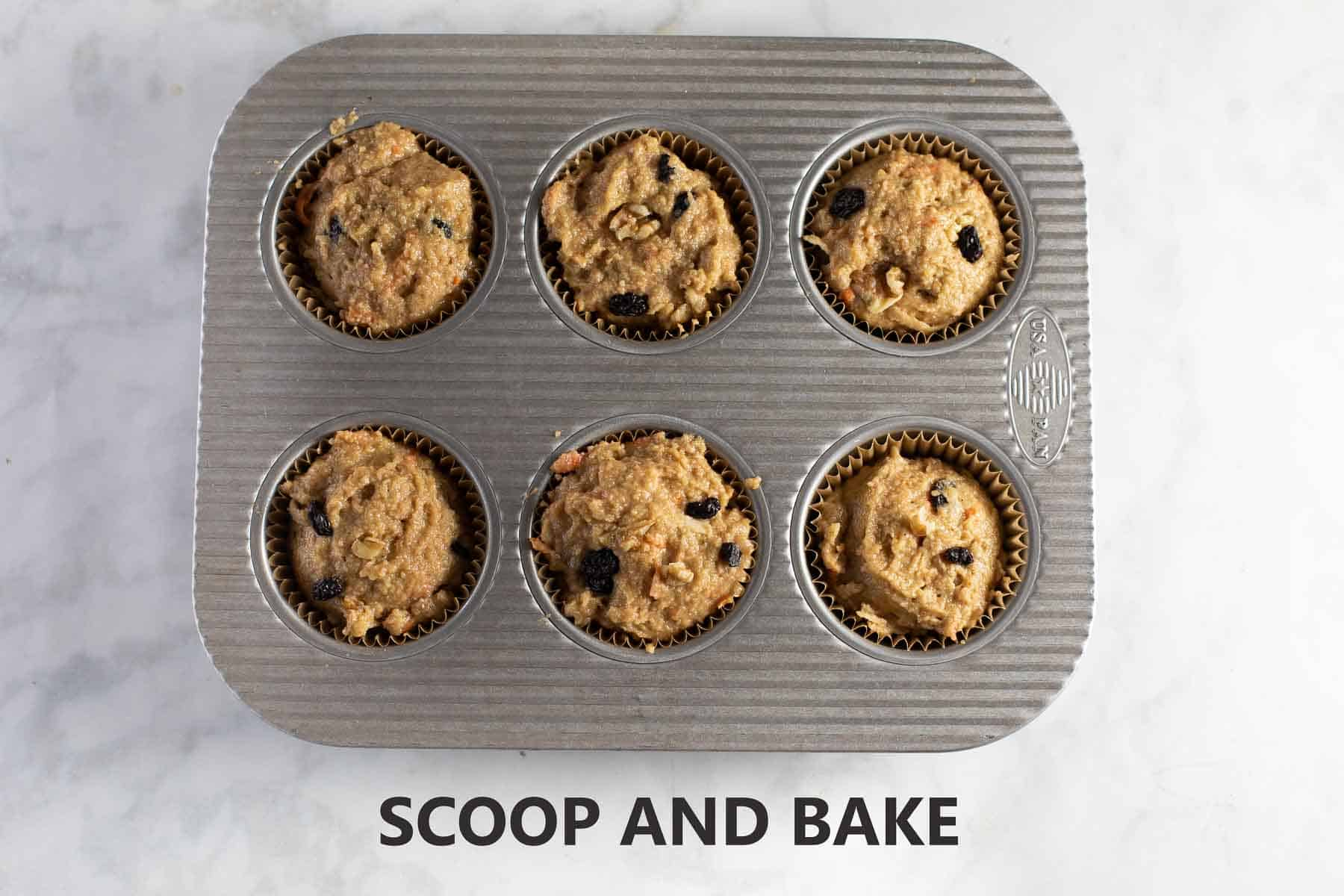 muffins scooped into baking pan