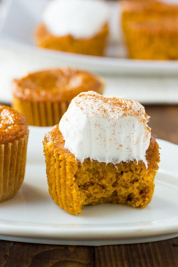 close up shot of pumpkin pie cupcakes with bite taken