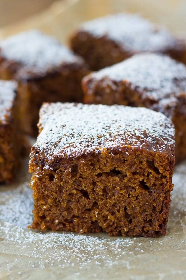 slice of gingerbread cake dusted with powdered sugar
