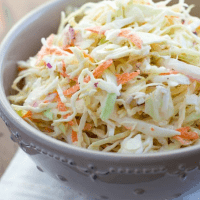 close up shot of coleslaw in gray bowl