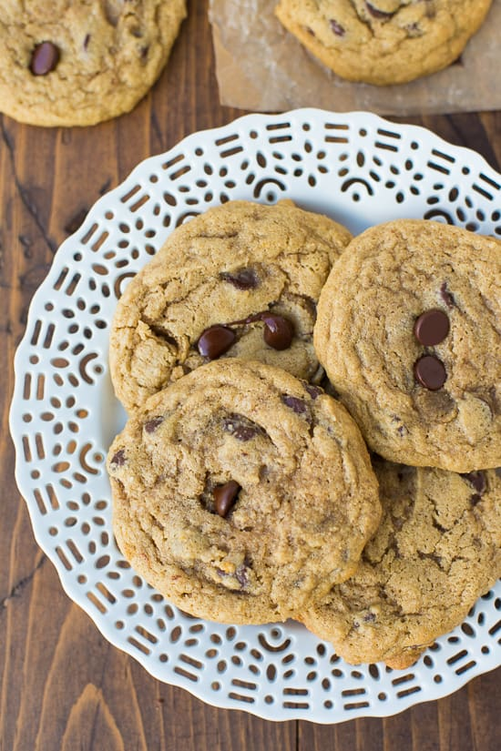 buckwheat chocolate chip cookies on white plate with wood background