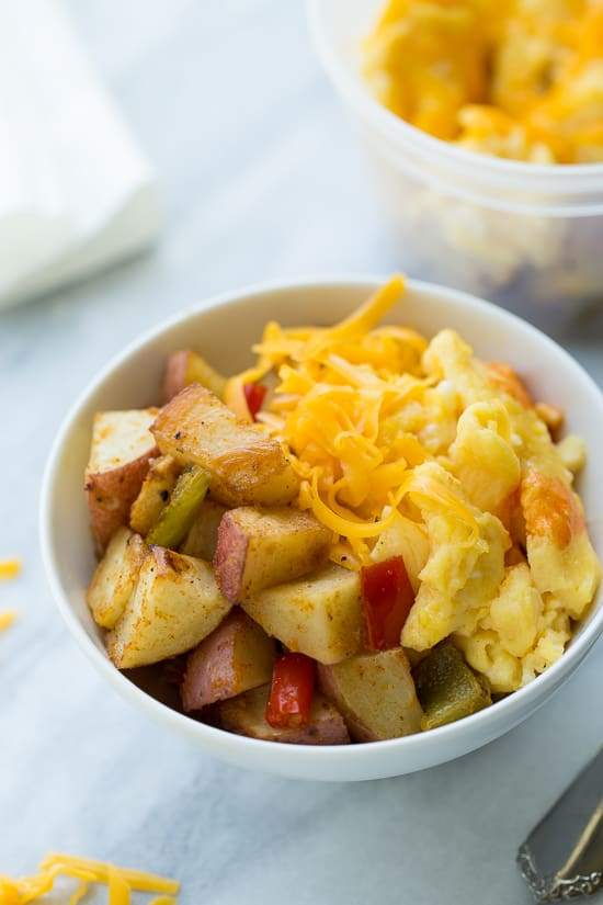 potatoes, egg and cheese in bowl on marble background