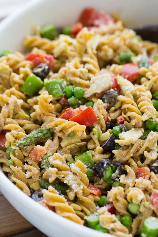 Tuscan Pasta Salad! Everyone always asks for the recipe and there are never any leftovers! So easy to make a full of flavor.