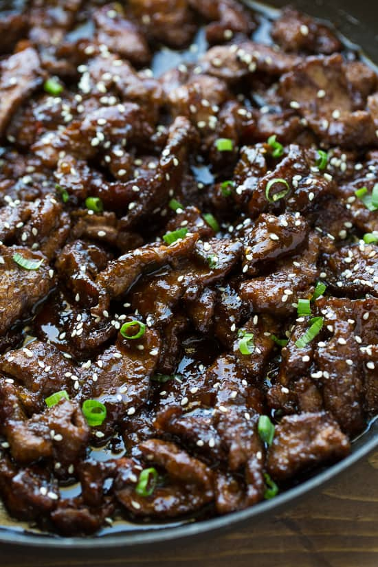 beef teriyaki in skillet with sauce