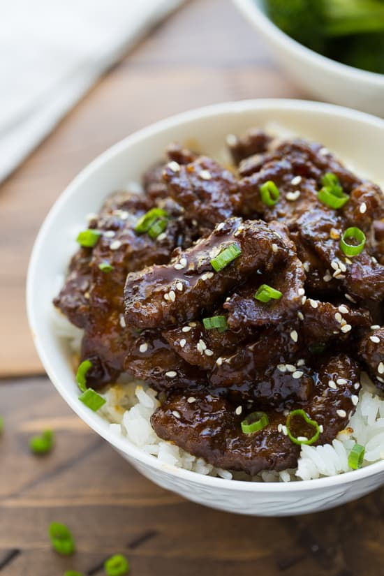 beef teriyaki in a bowl on bed of white rice
