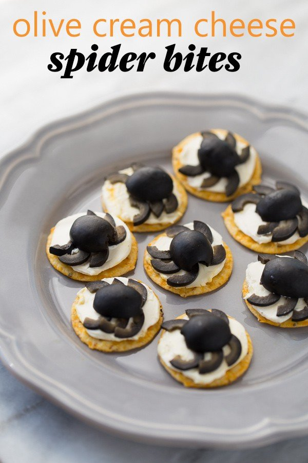 Olive Cream Cheese Spider Crackers on gray plate with marble background