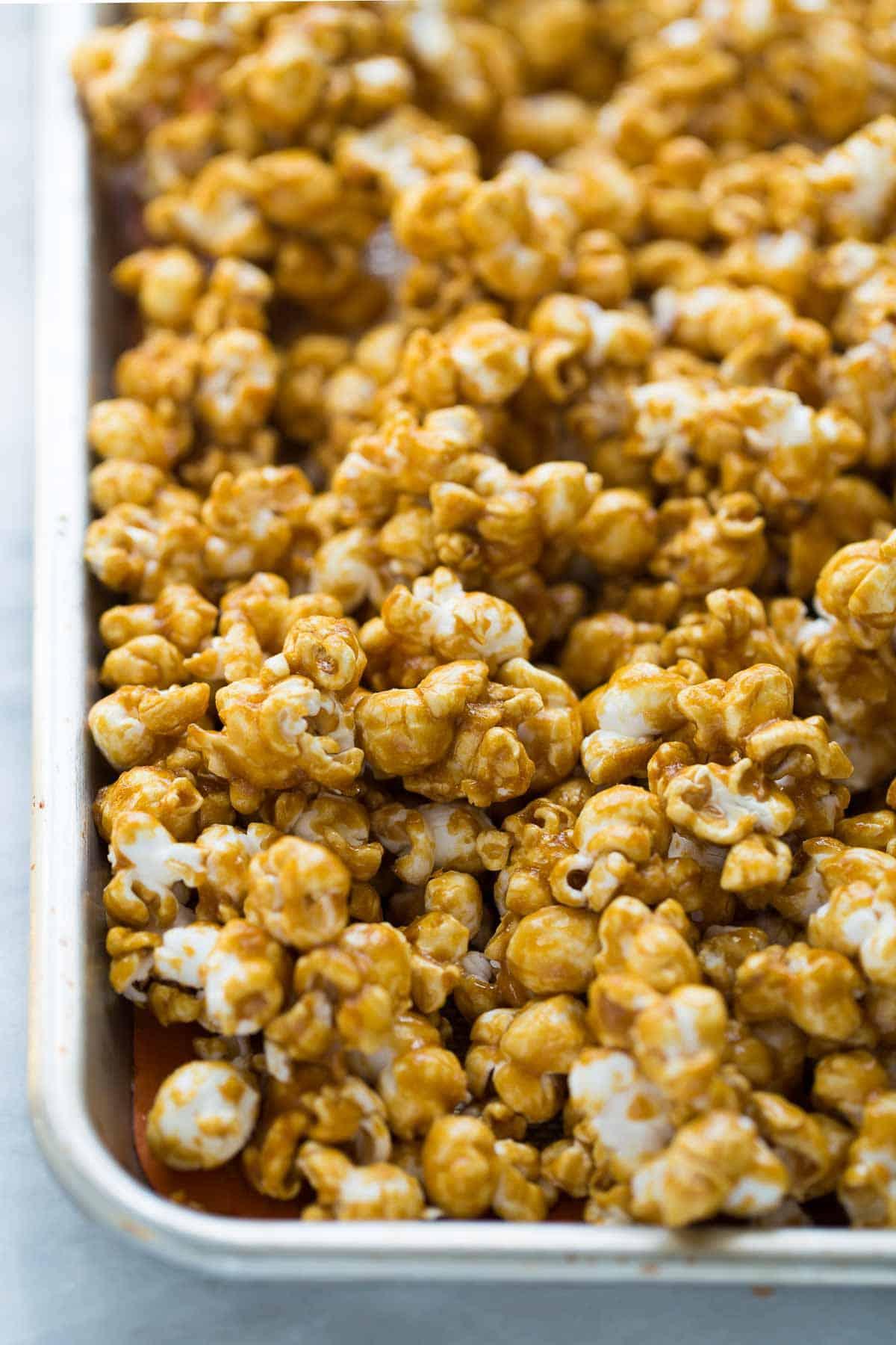 caramel corn on baking sheet