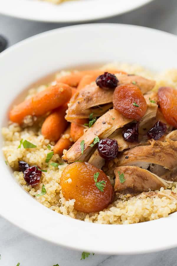 close up shot of slow cooker moroccan chicken over quinoa
