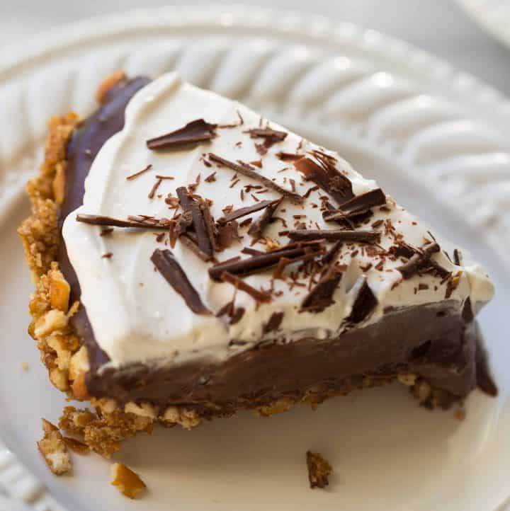 close up shot of chocolate pie on white plate