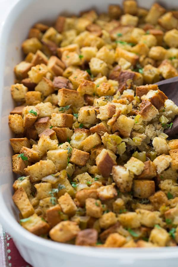 close up shot of stuffing in white casserole dish
