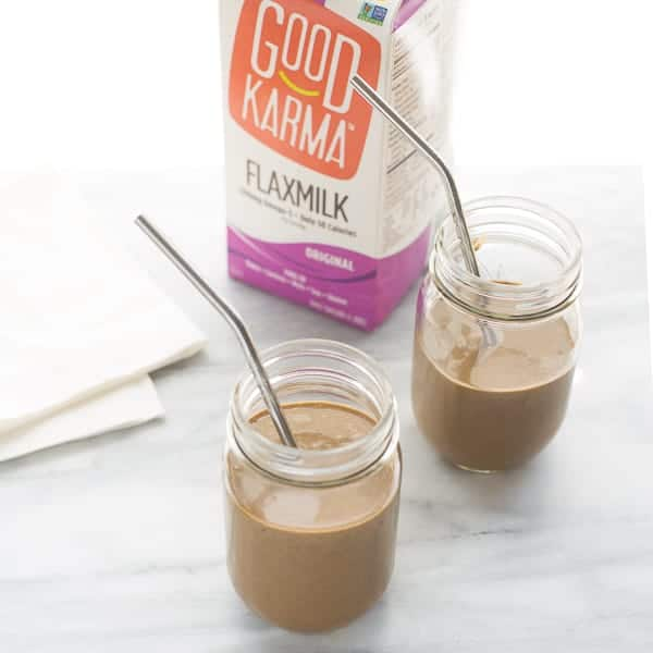 chocolate smoothie in glass jars with metal straw and Good Karma Flaxmilk
