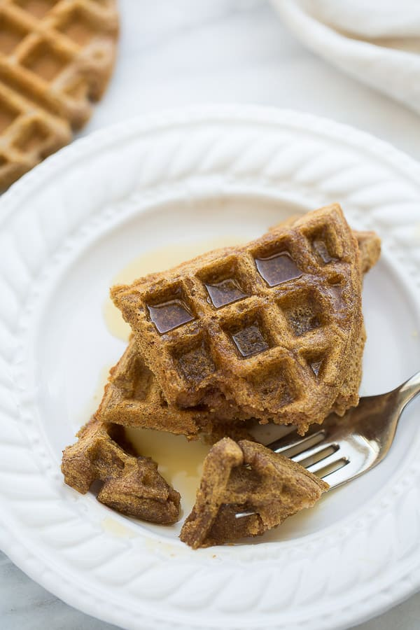 close up shot of buckwheat waffle with maple syrup