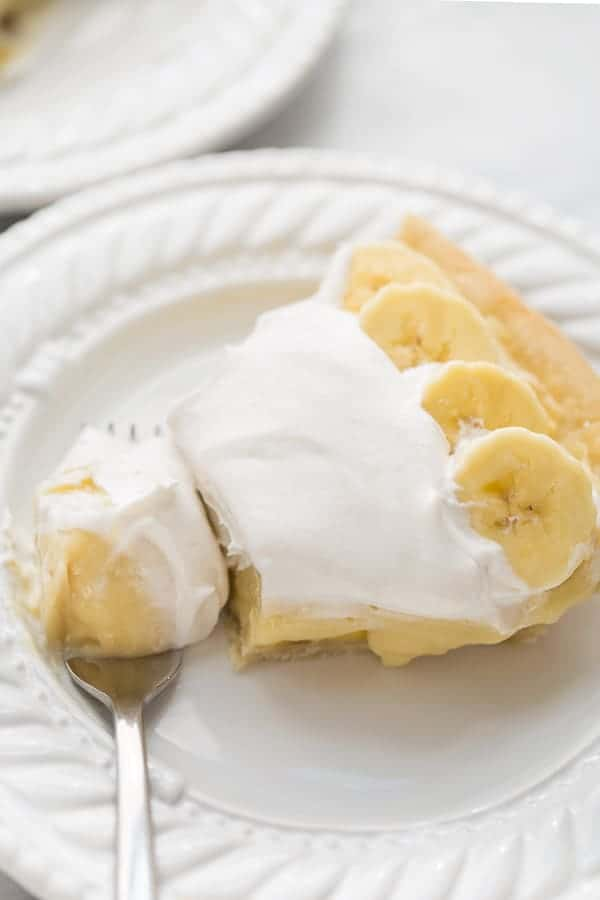 banana cream pie with fork taking bite