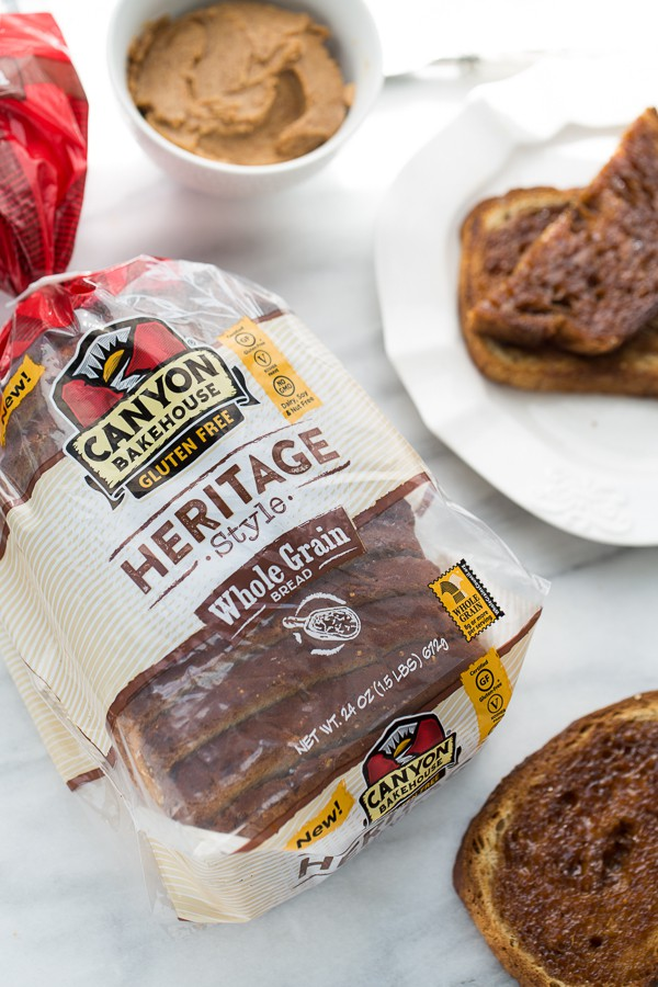 loaf of heritage bread on white marble background with toast