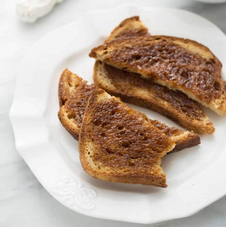cinnamon toast on white plate with marble background