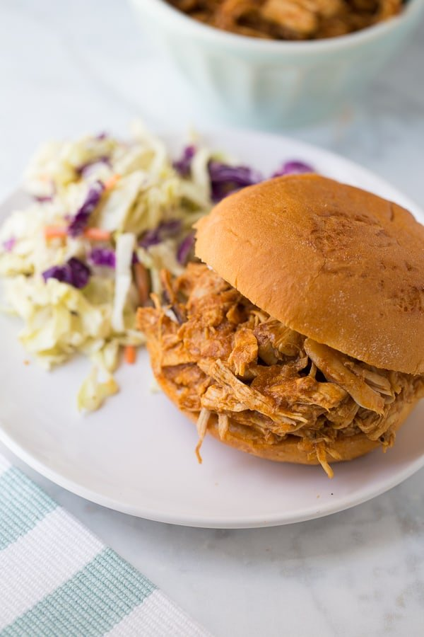 bbq chicken served on bun with coleslaw