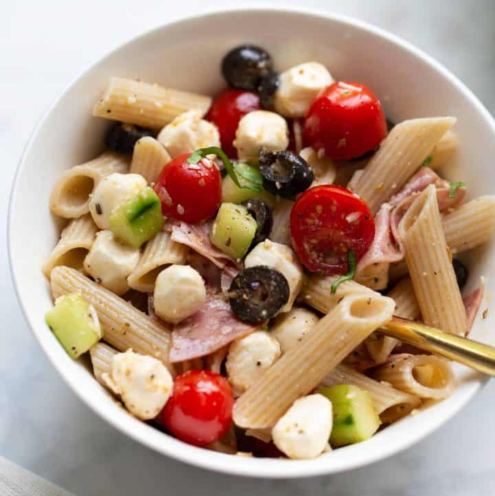 close up shot of pasta salad in white bowl