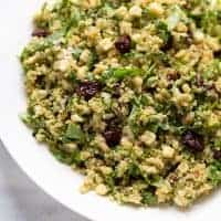 close up shot of quinoa salad in white serving dish