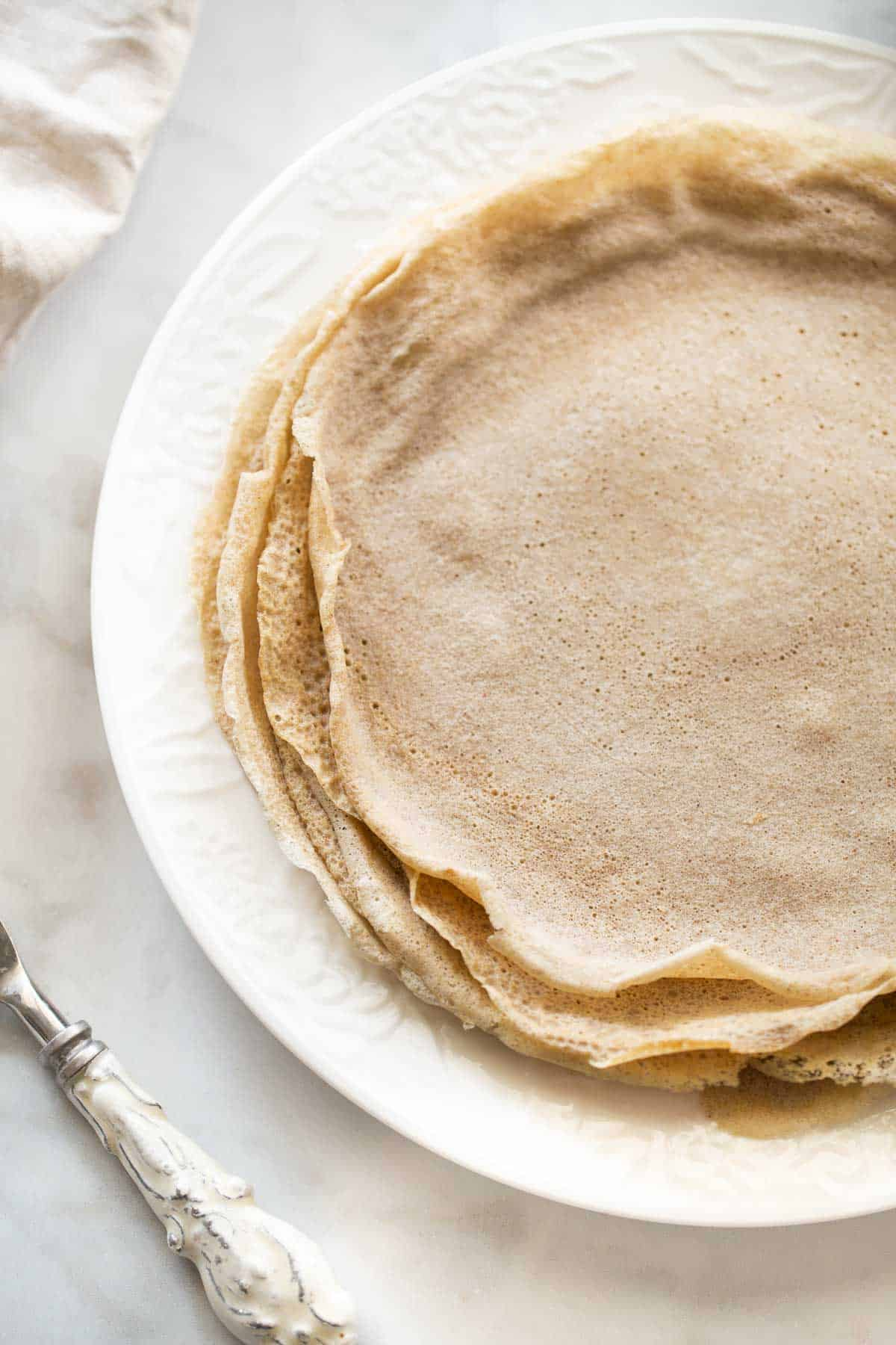 close up shot of buckwheat crepes on white plate